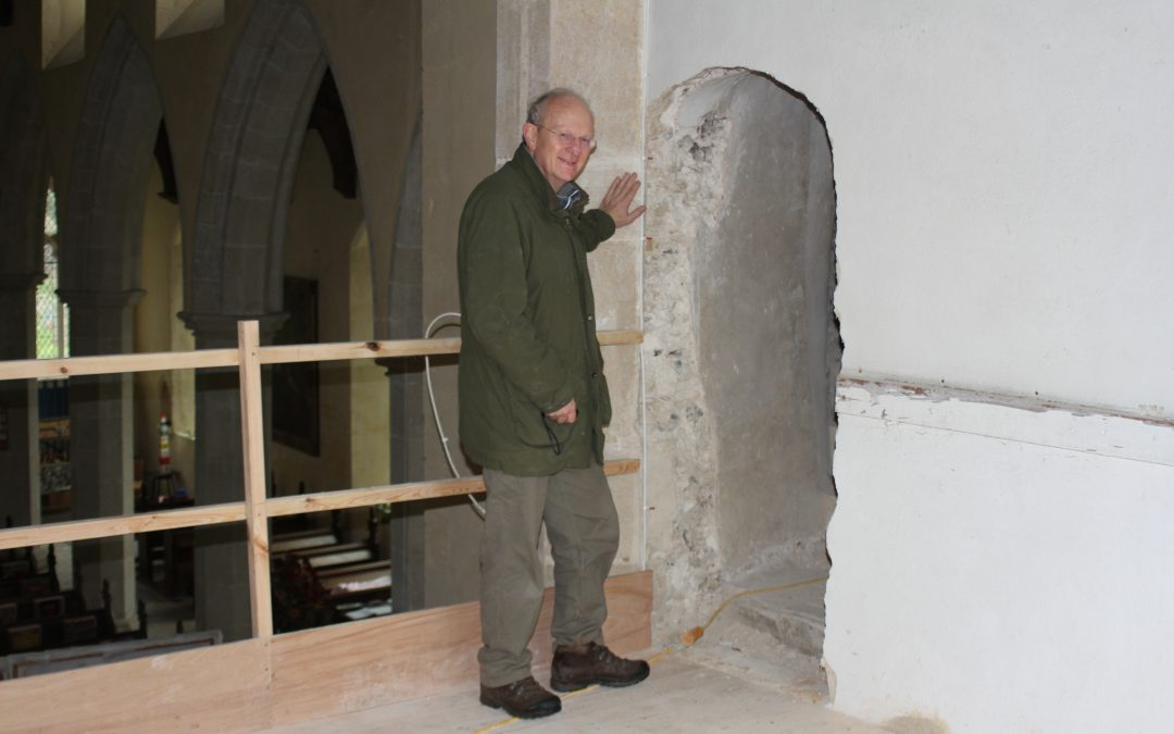 Malcolm Currie at the newly opened doorway in Hitcham's church tower